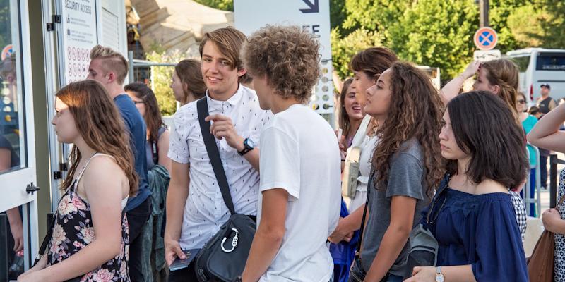 Teenagers in Queue